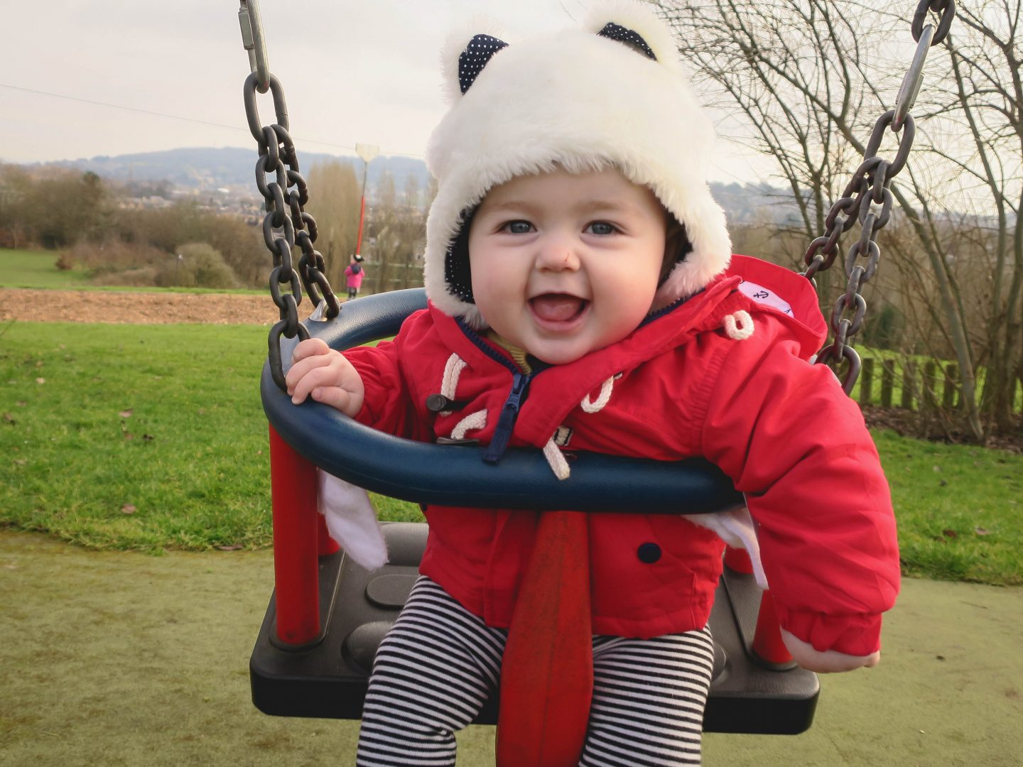 Nine Month Old Enjoying The Swings