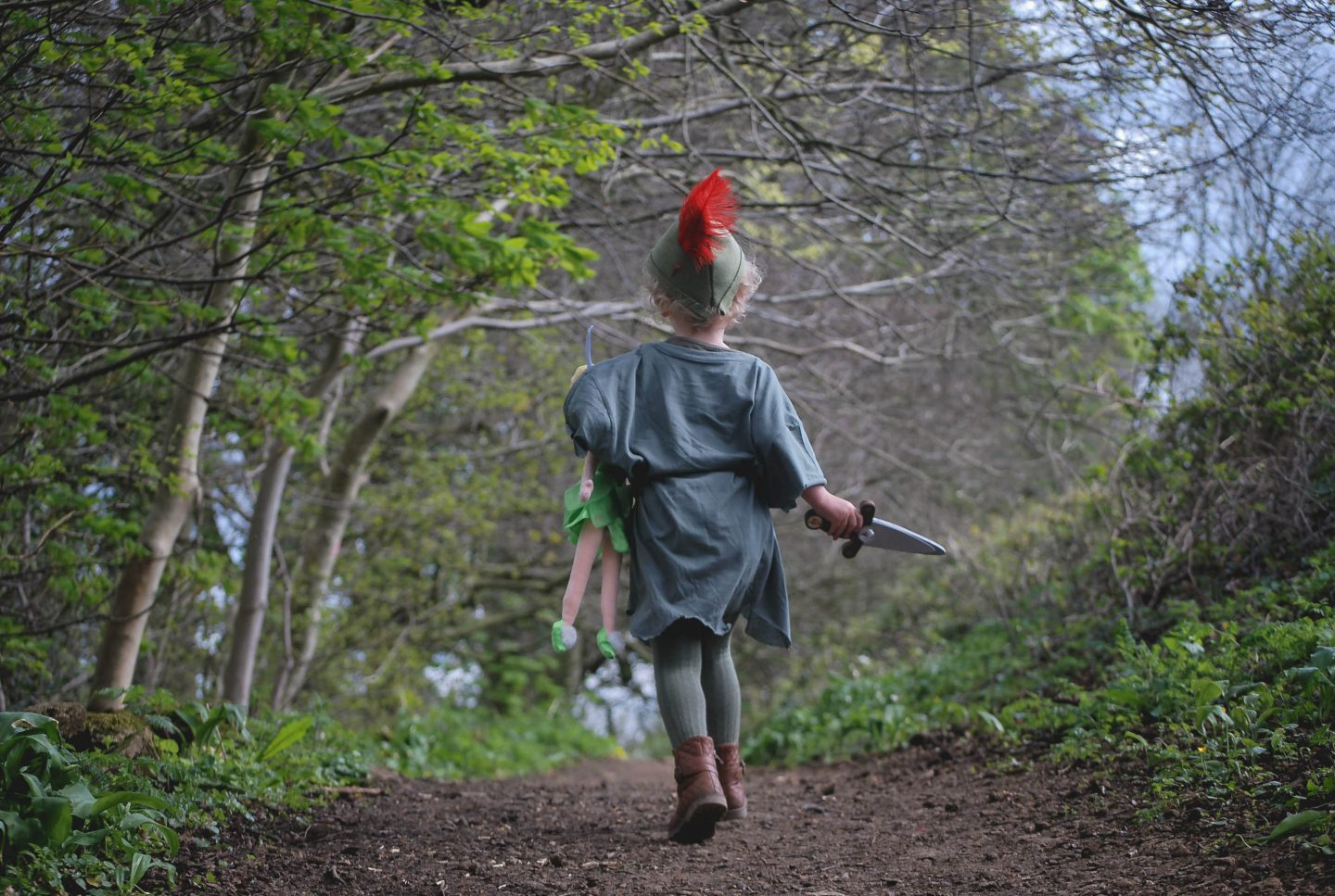 My cute daughter running through the woods dressed as Disney's Peter Pan