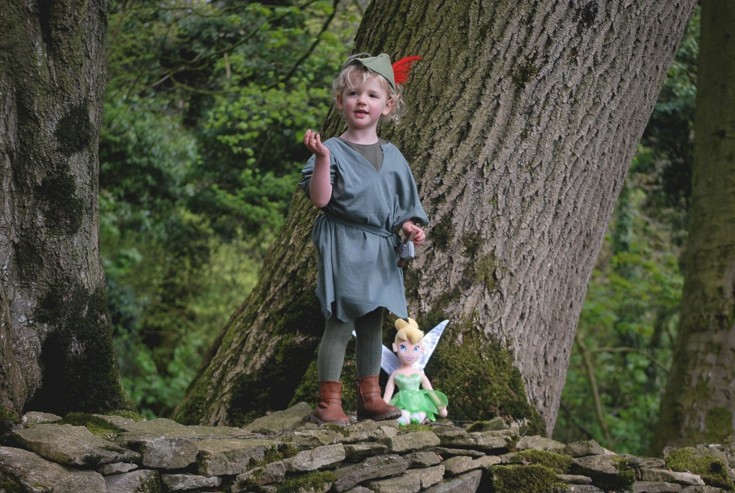 My cute daughter dressed as Disney's Peter Pain in the woods