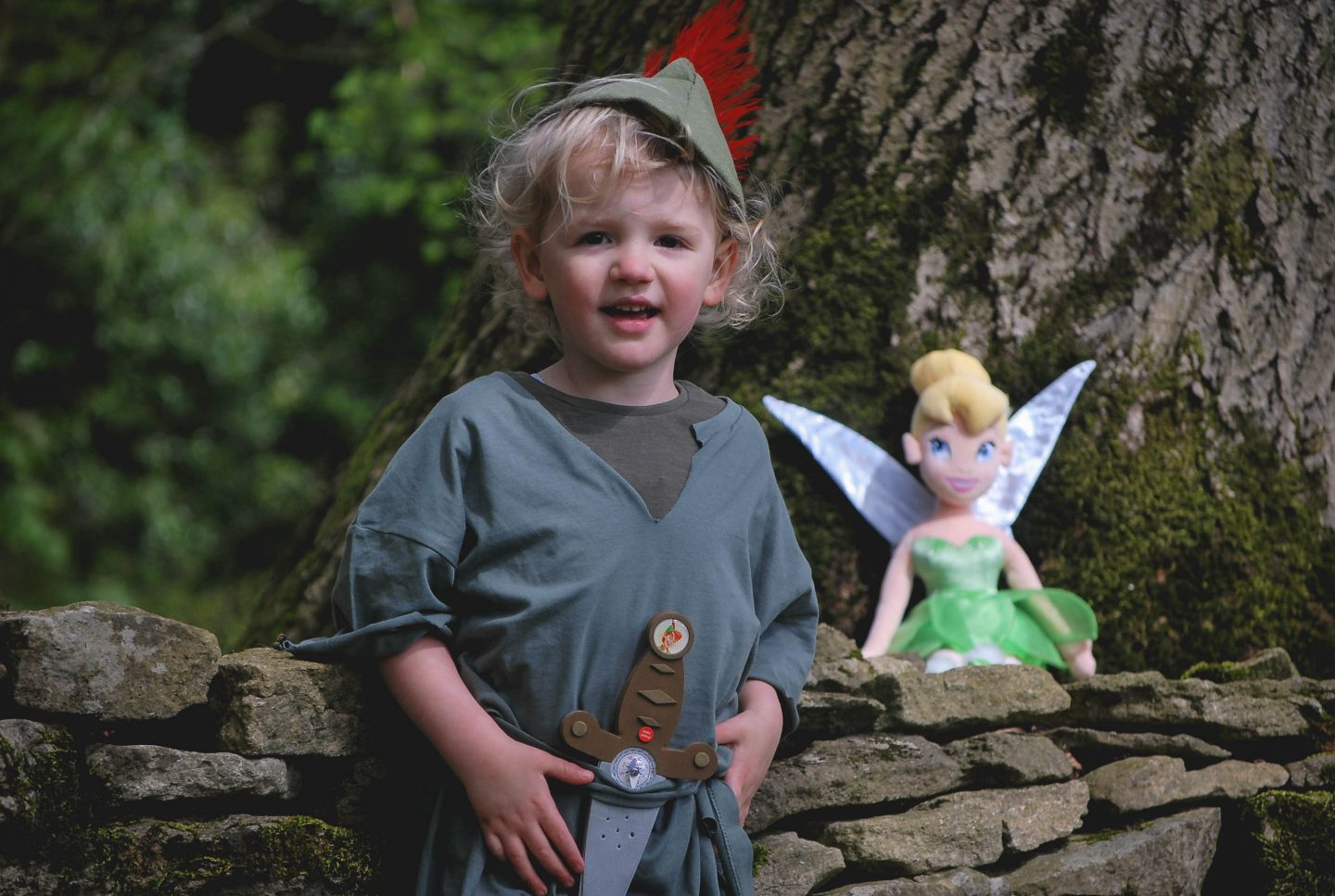Dressed as Peter Pan with Tinkerbell